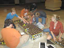 kids building project out of cans