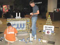 kids working on project made from cans