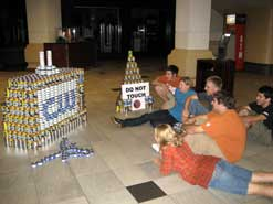 kids looking at project made of cans