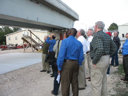 group looking at concrete beam