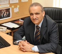 Bilal Hamad sitting at desk smiling