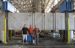 three people standing inside FSEL warehouse